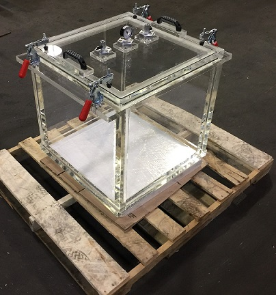large rectangular clear acrylic vacuum chamber on pallet